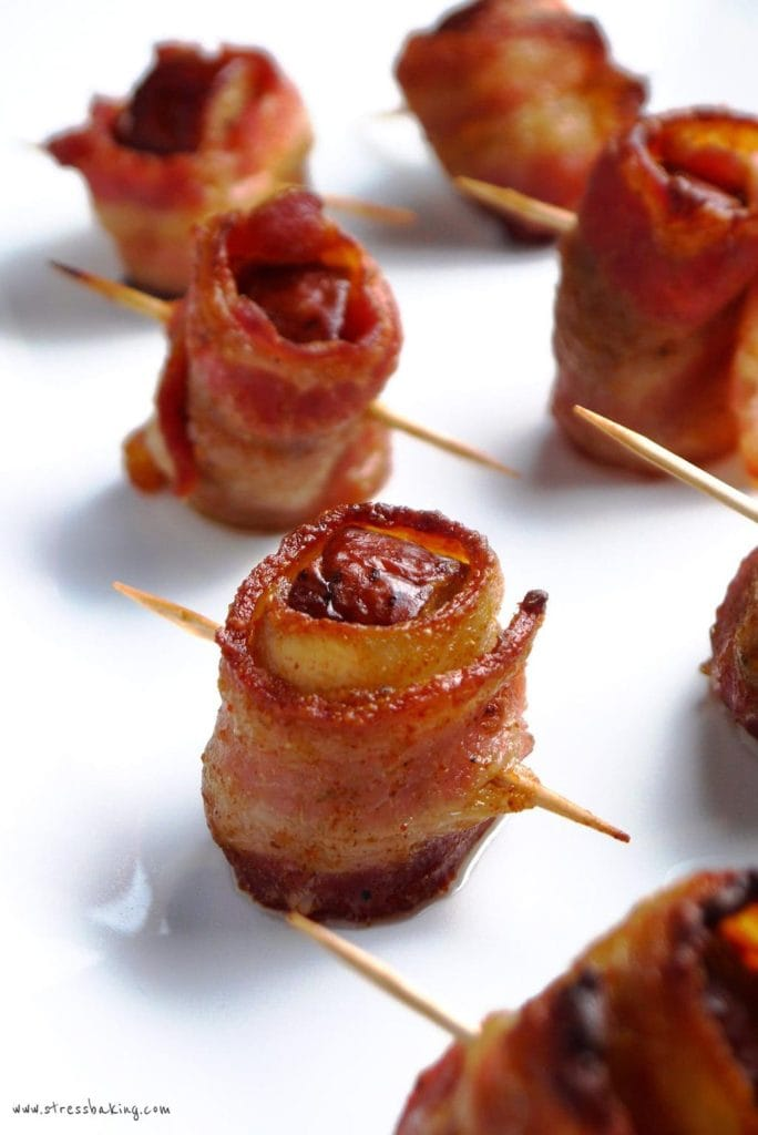 Bacon Wrapped Kielbasa: Smoky kielbasa wrapped in thick cut bacon is complemented by a slightly sweet and spicy mustard glaze. | stressbaking.com