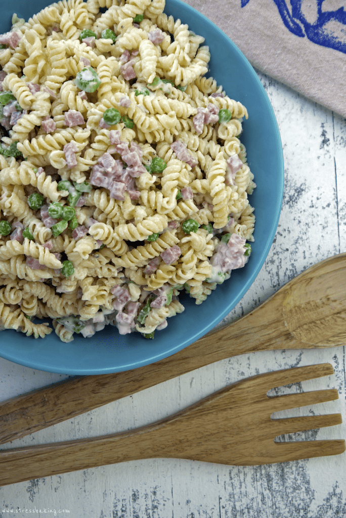 Copycat Ruby Tuesday Pasta Salad in a blue bowl with wooden utensils