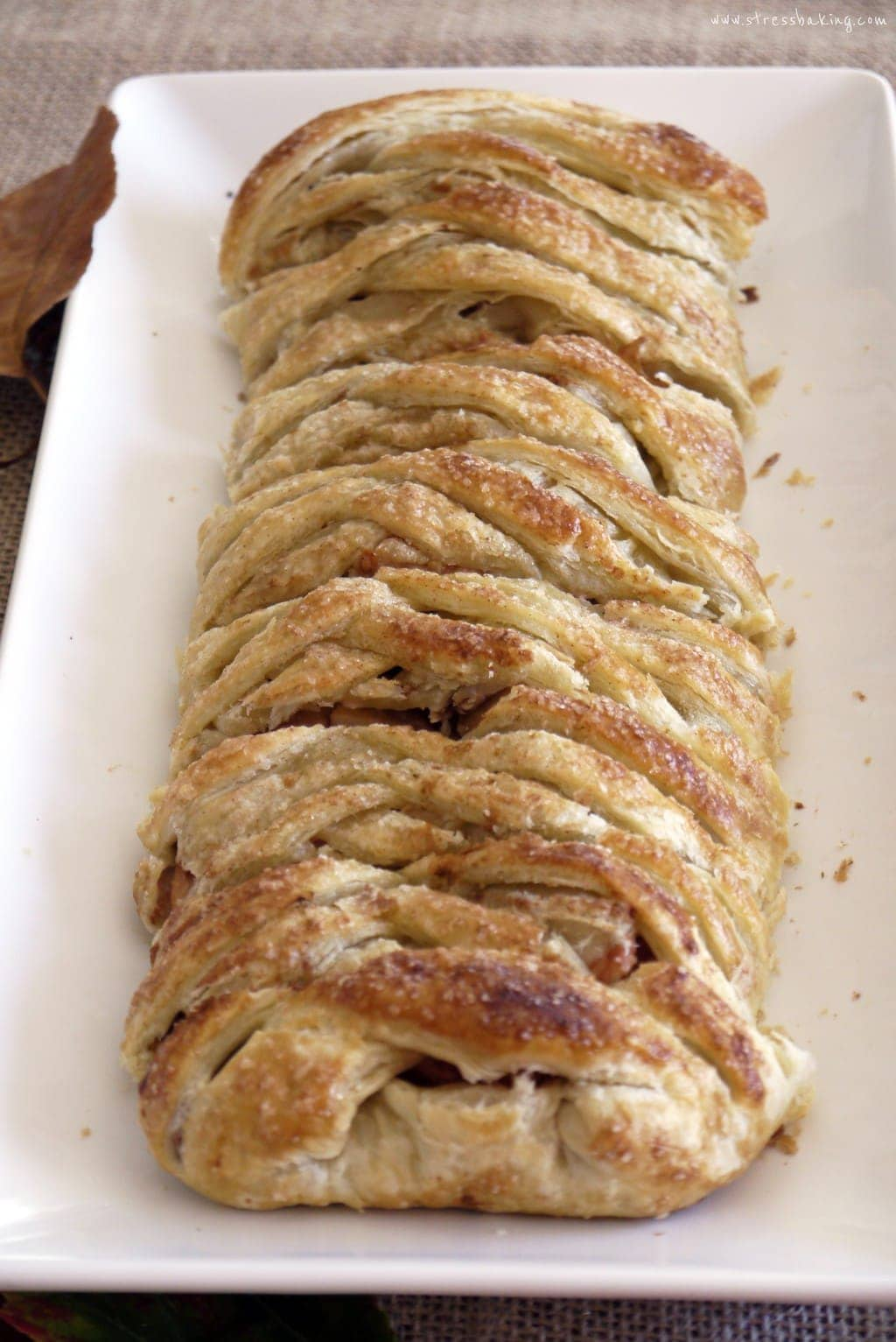 Apple Strudel: Traditional Viennese strudel made easy with frozen puff pastry! A crisp, golden crust filled with sweet cinnamon sugar and tart apples. | stressbaking.com @stressbaking #stressbaking #applestrudel #strudel #pastry #apple #easyrecipe #dessert