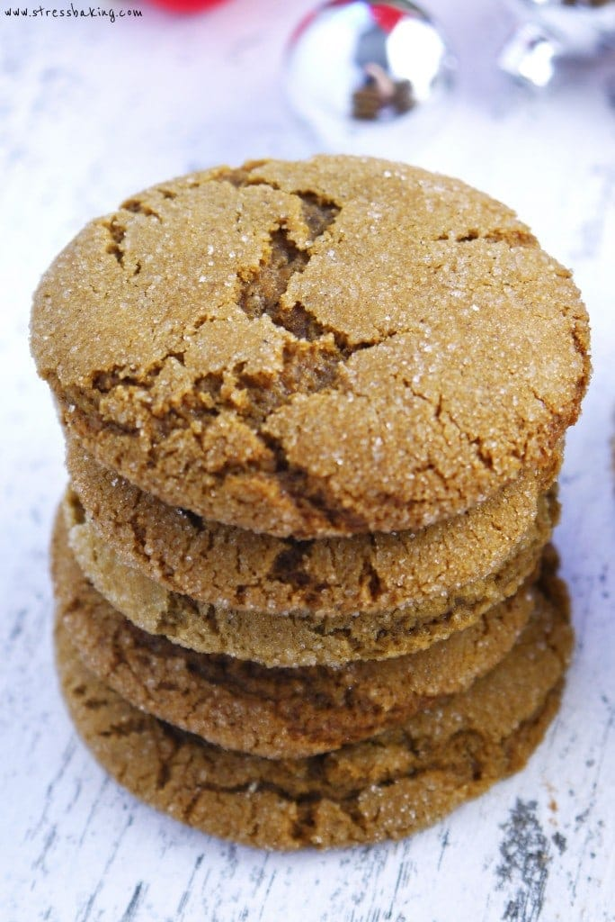Chewy Ginger Molasses Cookies: These chewy cookies are packed with ginger and molasses, with a subtle sweetness to satisfy your sweet tooth. Dip them in white chocolate and decorate with sprinkles for some holiday flair! | stressbaking.com