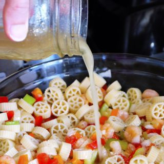 Shrimp Pasta Salad: A colorful, simple pasta salad with homemade Italian vinaigrette and shrimp that's sure to be a hit at your next summer party! | stressbaking.com #pastasalad #shrimp