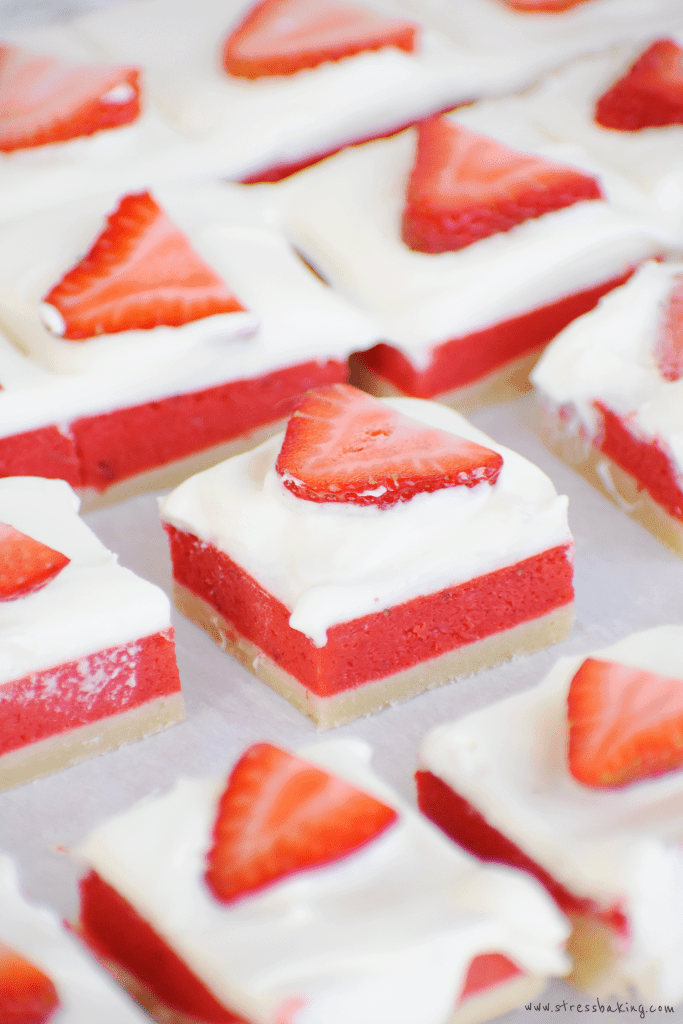 Strawberry Rhubars: These gorgeous three layer bars are a guaranteed crowd-pleaser! A lemon cream cheese base is topped with sweet strawberry and tart rhubarb, and it's all topped with fluffy whipped cream and fresh strawberry slices. | stressbaking.com