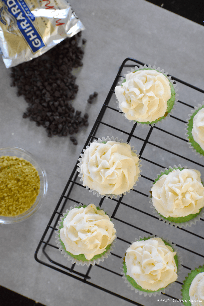 Pistachio cupcakes with cannoli frosting: Gorgeouslygreen, light, fluffy pistachio cupcakes topped with a creamy cannoli frosting with hints of orange and lemon zest! | stressbaking.com