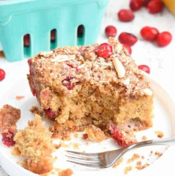 Paleo Cranberry Coffee Cake: Tender cake is packed with tart cranberries and a hint of orange zest, and loaded with slivered almonds and a sweet crumb topping.   stressbaking.com