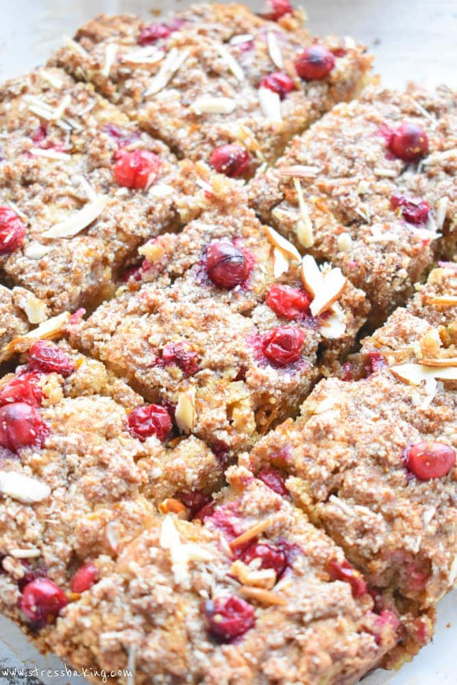 Paleo Cranberry Coffee Cake: Tender cake is packed with tart cranberries and a hint of orange zest, and loaded with slivered almonds and a sweet crumb topping. | stressbaking.com