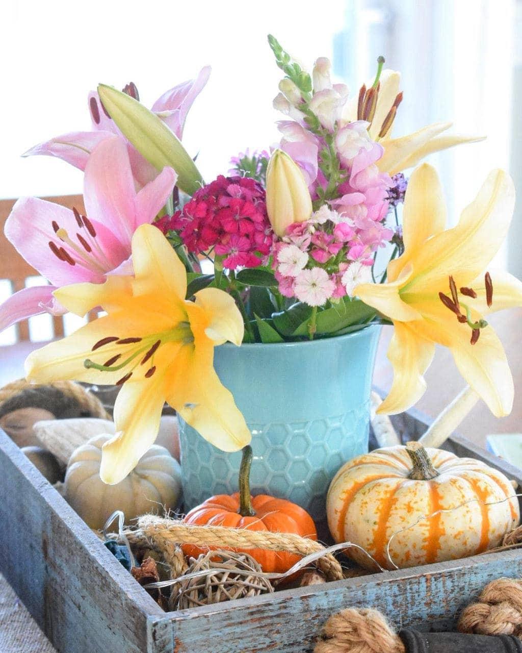 Flowers with decorative pumpkins