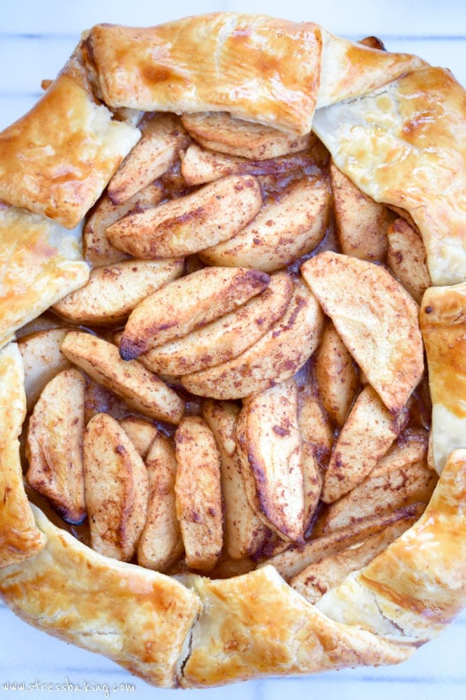 Paleo Apple Galette: Tart apples combine with the sweet flavors of cinnamon, honey and coconut sugar, a crispy gluten free crust and a slightly nutty maple drizzle for the perfect fall dessert! | stressbaking.com