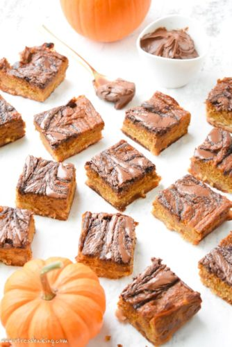 Paleo Nutella Swirled Pumpkin Pie Bars: The perfect alternative to pumpkin pie! Homemade Nutella swirl through a thick layer of pumpkin pie filling, sitting atop a shortbread crust - you won't believe they're gluten free, dairy free, and paleo.   stressbaking.com