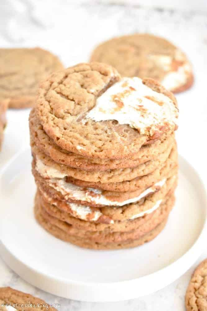 Closeup shot of a stack of peanut butter cookies swirled with marshmallow fluff on a small white plate