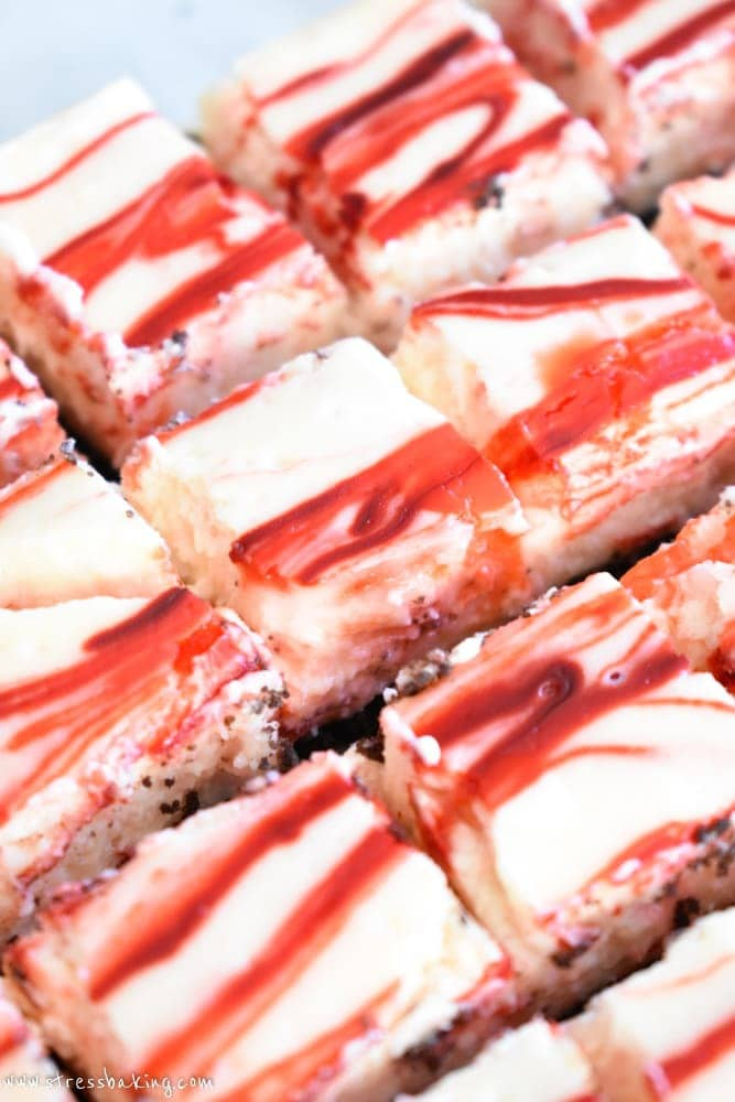 Peppermint Bark Cheesecake Bites: A chocolate cookie crust is topped with creamy and rich peppermint cheesecake, loaded with white chocolate peppermint pieces, crushed candy canes and topped off with more chocolate. Holiday dessert perfection!   stressbaking.com