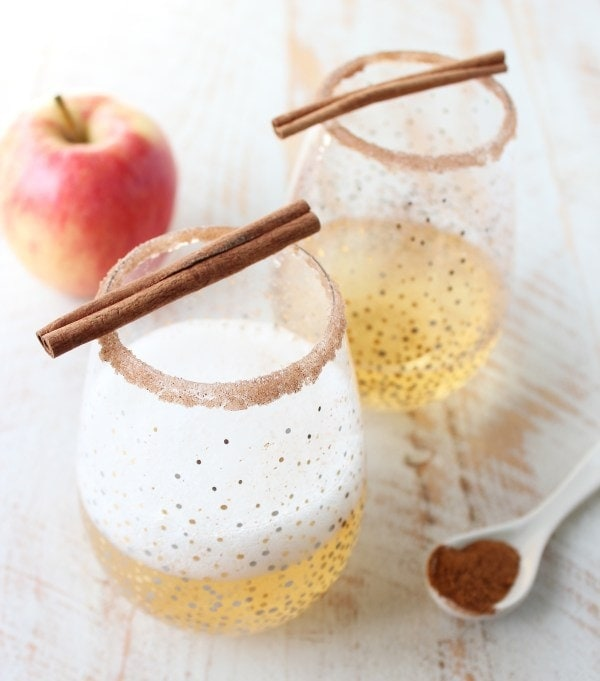 Apple Cider Champagne Cocktail: Rich apple cider is paired with sparkling champagne, vodka, maple syrup, cinnamon and nutmeg to make a festive fall apple cider champagne cocktail! | whitneybond.com