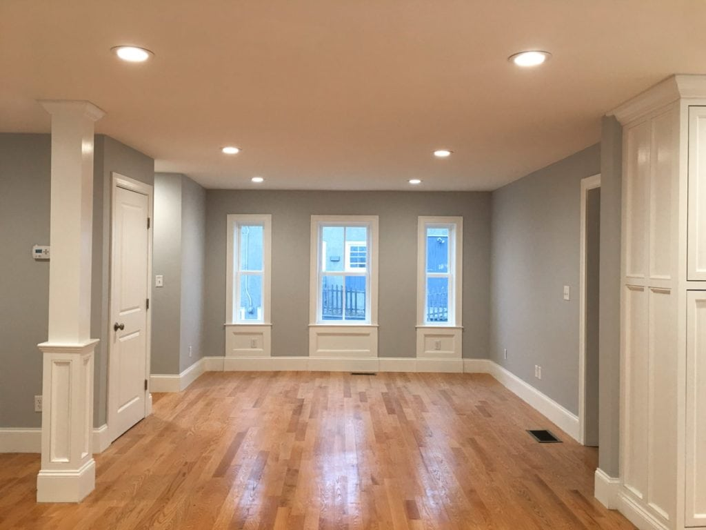 Dining room with hardwood floors, gray walls and white trim