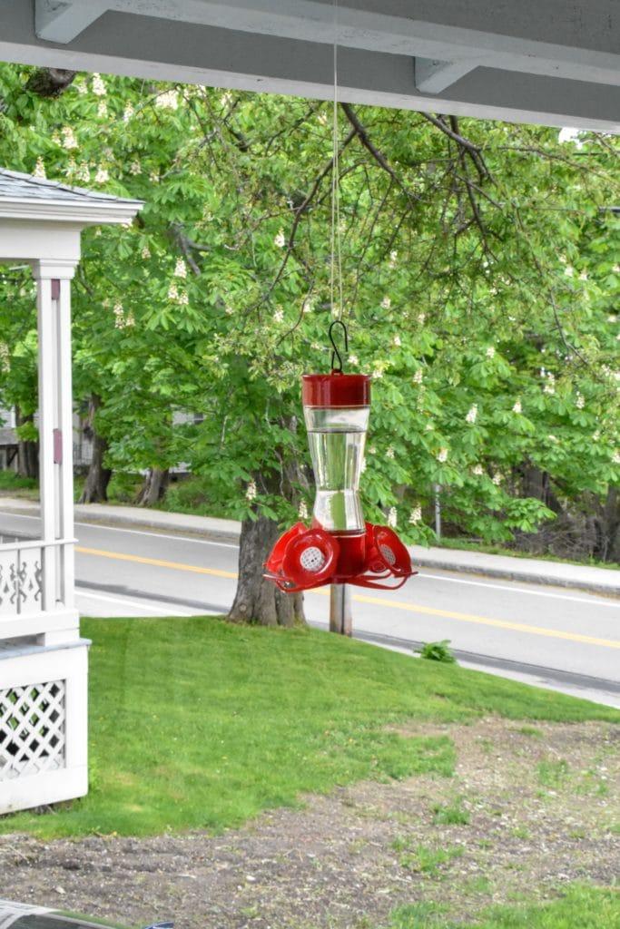 Hummingbird feeder on a porch