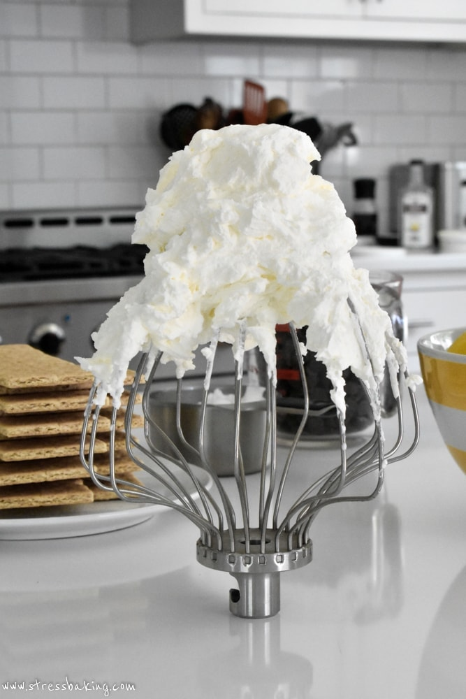 Mascarpone whipped cream on a whisk