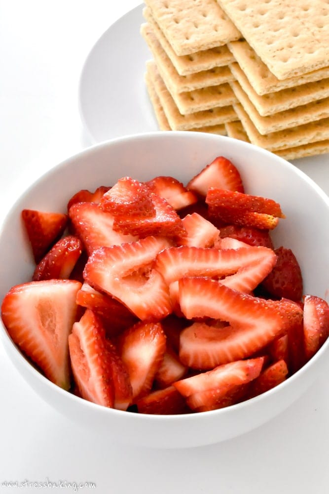 Sliced strawberries in a white bowl