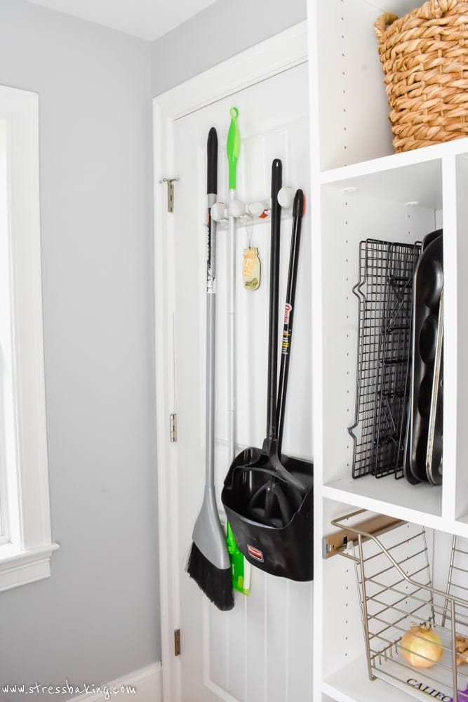 California Closets Cleaning tools hanging on back of door