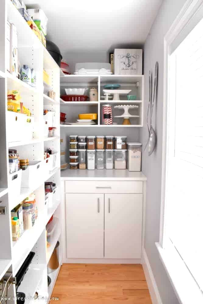 California Closets White pantry shelving with cabinet and drawer