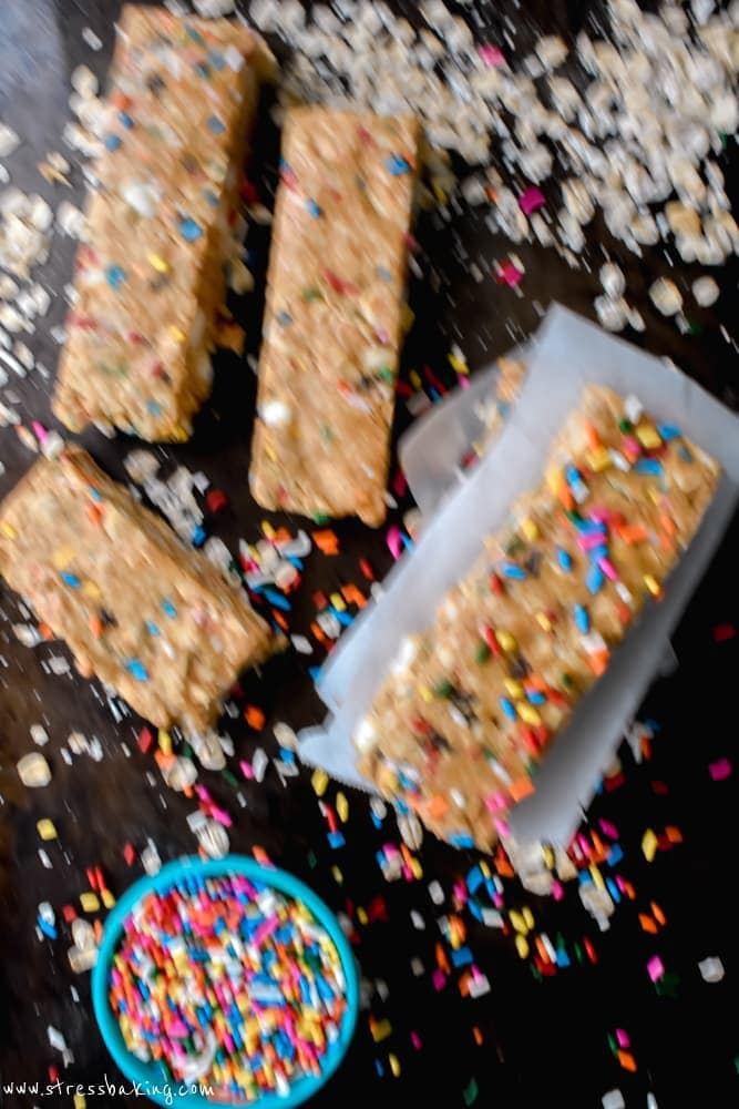 Chewy Funfetti Granola Bars being knocked over by a dog