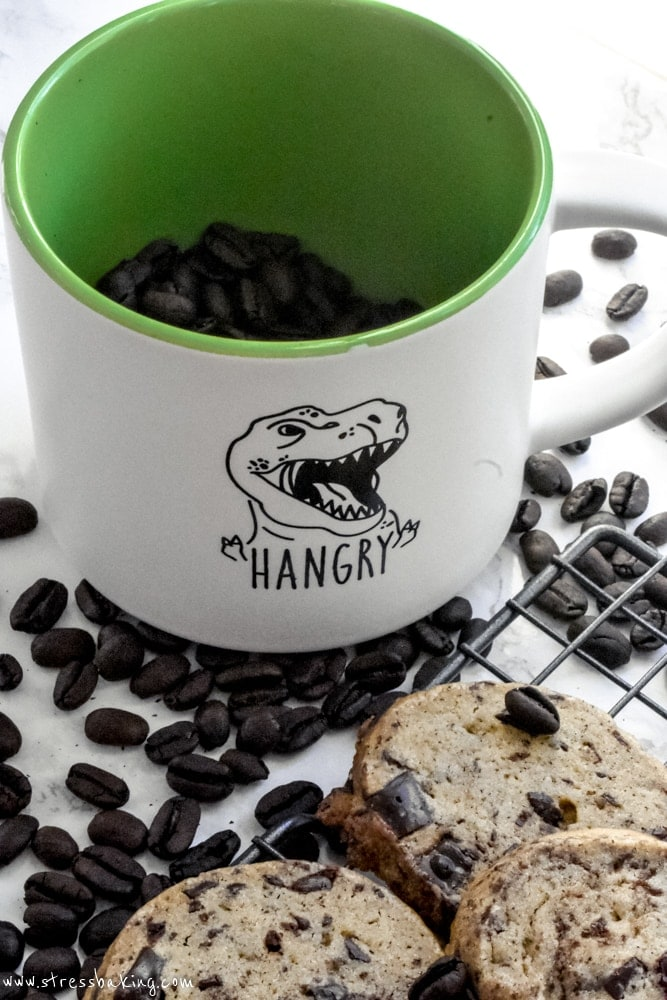 "Chocolate Chunk Espresso Slice and Bake Cookies and a ""Hangry"" dinosaur mug"