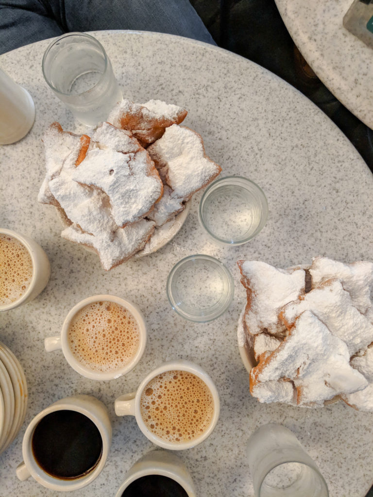 Beignets and coffee at Cafe Du Monde in New Orleans