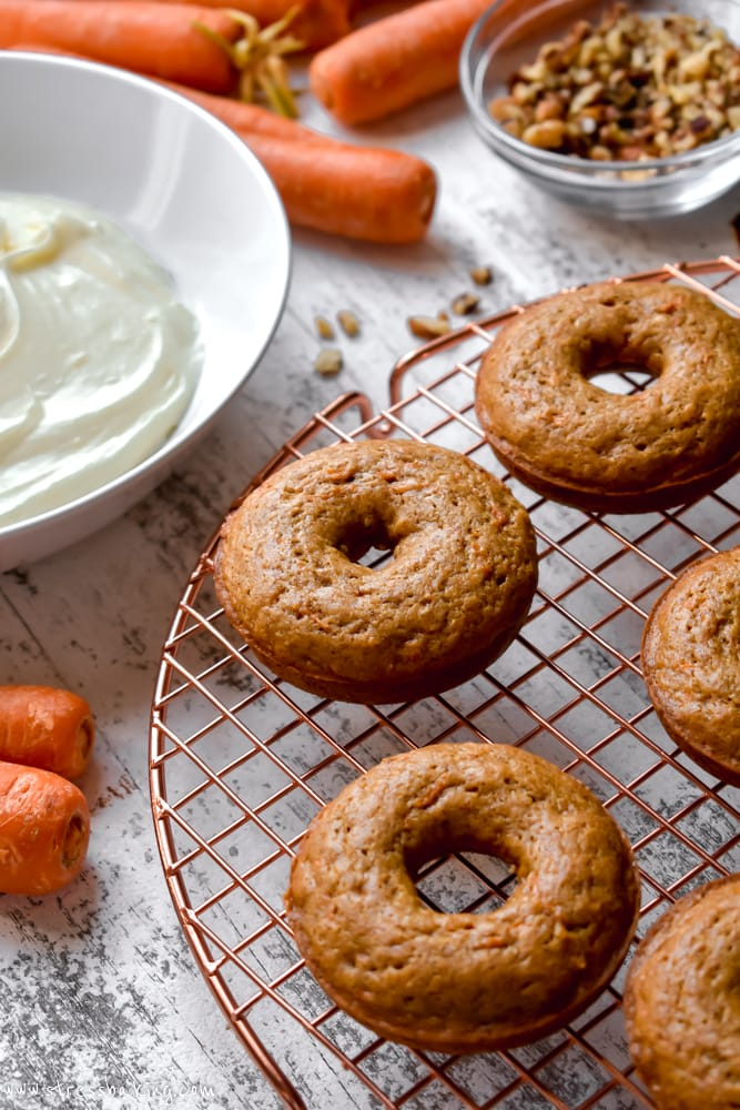Carrot cake donuts on a cooling rack