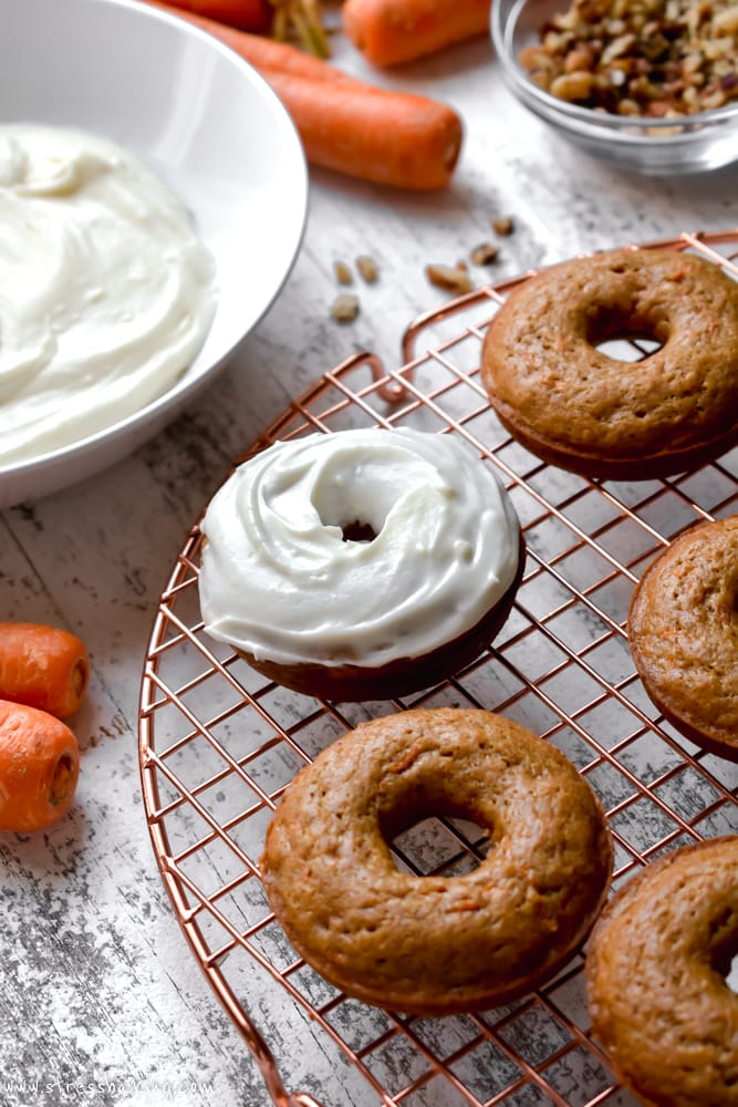 Carrot cake donuts topped with cream cheese icing