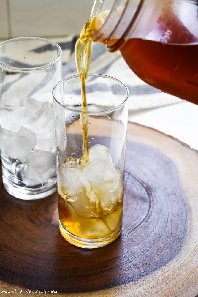 Cold brew coffee being poured into glass of ice