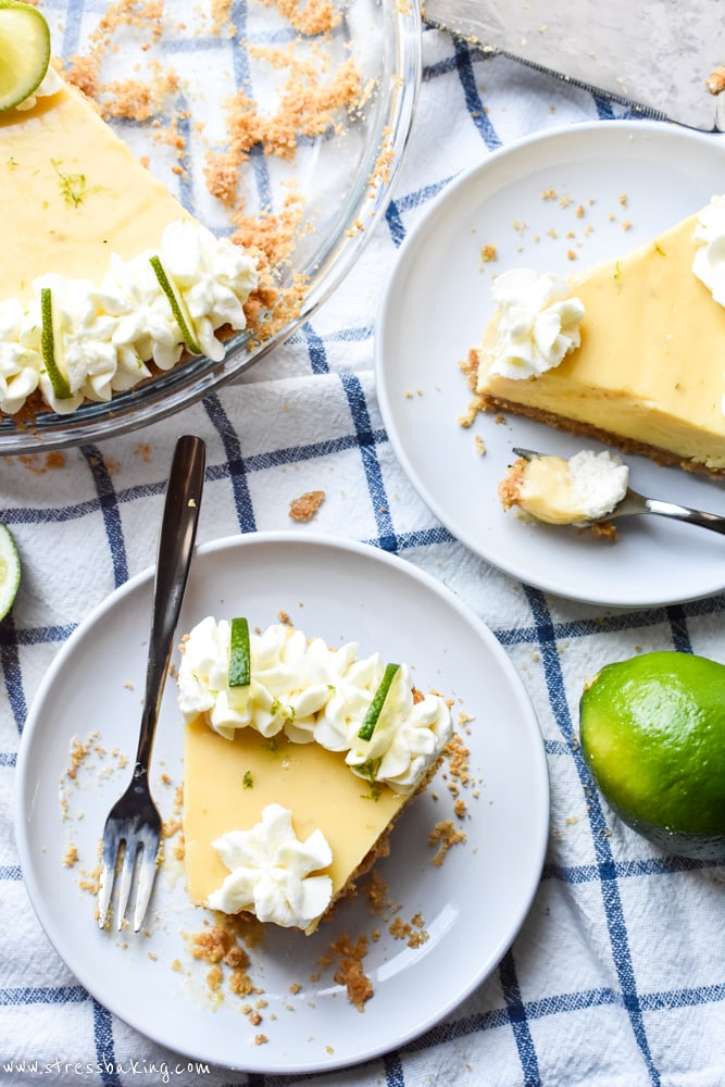 Key Lime Pie slices on a blue and white dish towel