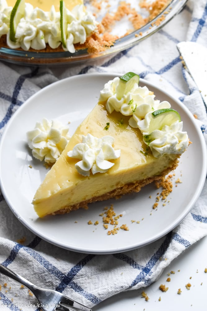 Key Lime Pie slice on a blue and white dish towel