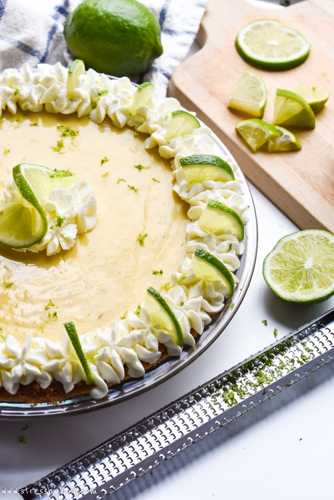 Key Lime Pie with a lime and zester