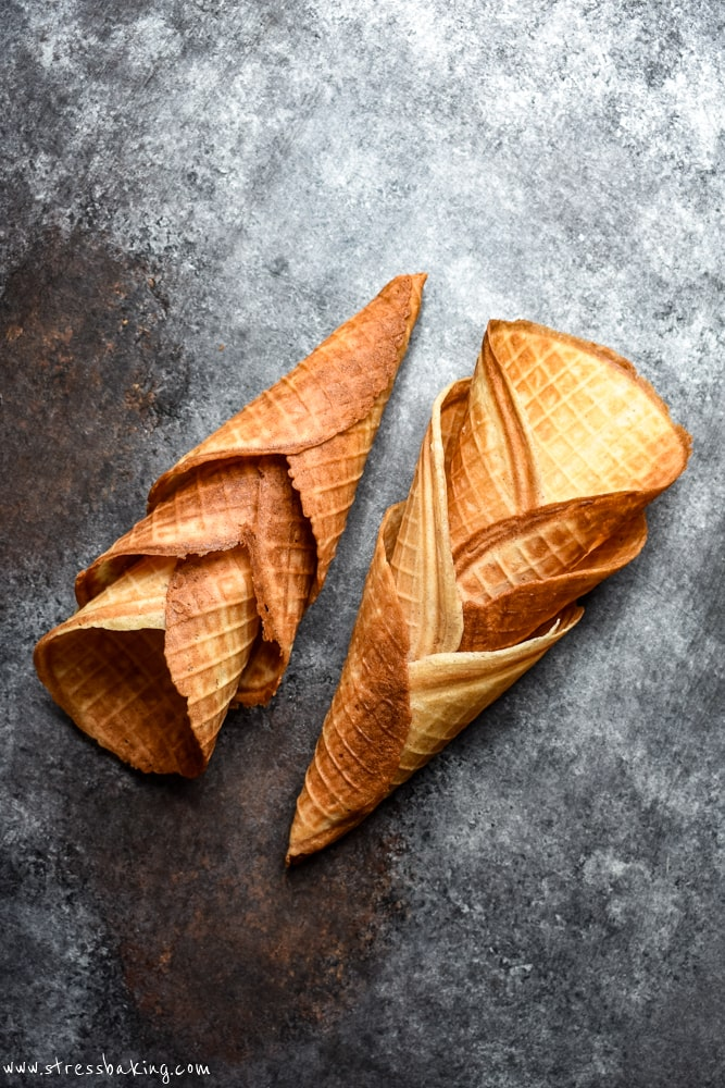 Waffle cones stacked on their sides on a cookie sheet