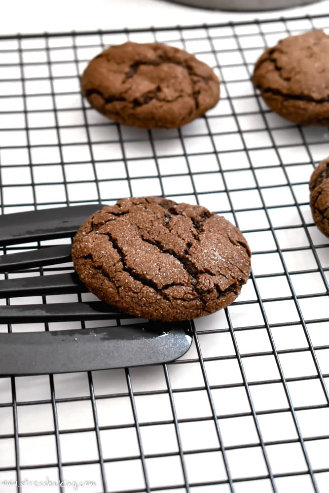 Chewy Mexican Hot Chocolate Cookie being lifted off a wire rack