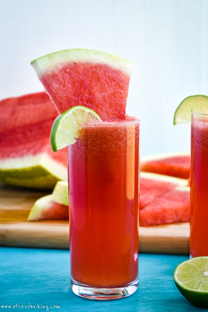 Watermelon agua fresca with a lime wedge and slice of watermelon