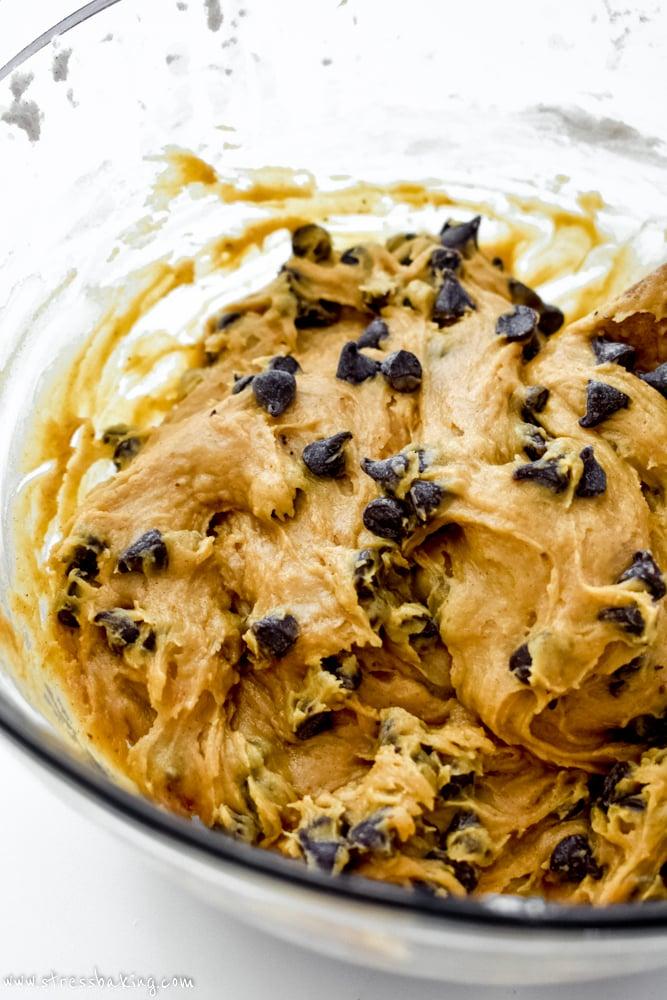 Pumpkin chocolate chip cookie dough in a clear bowl
